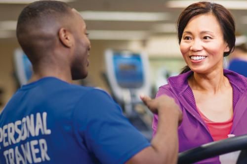 Personal Trainer helping YMCA member