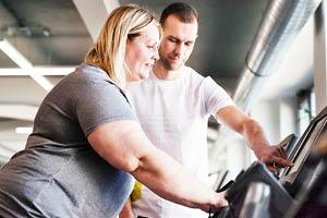 Trainer working with member on weight loss goals